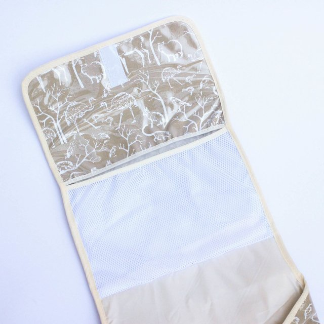 Portable Changing Mat, beige with white animals on internet