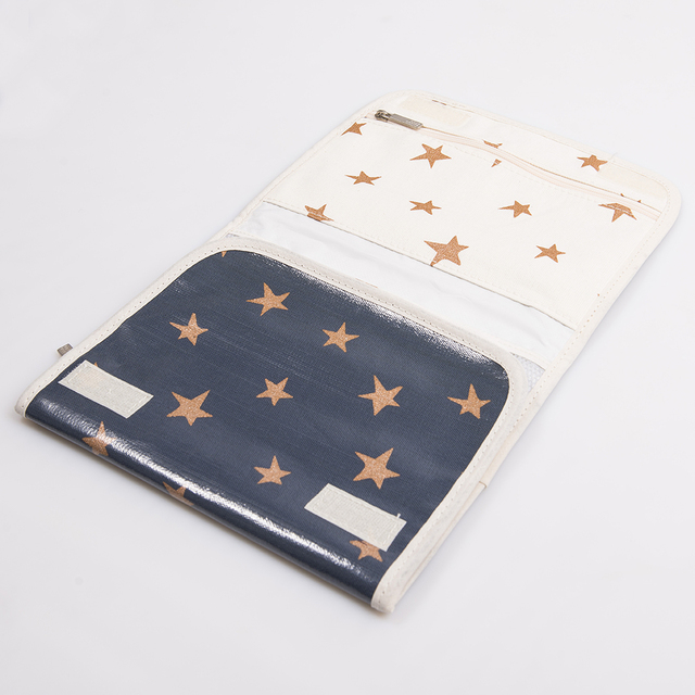 Aguamarina Pouch, plasticized, blue with cooper stars   on internet