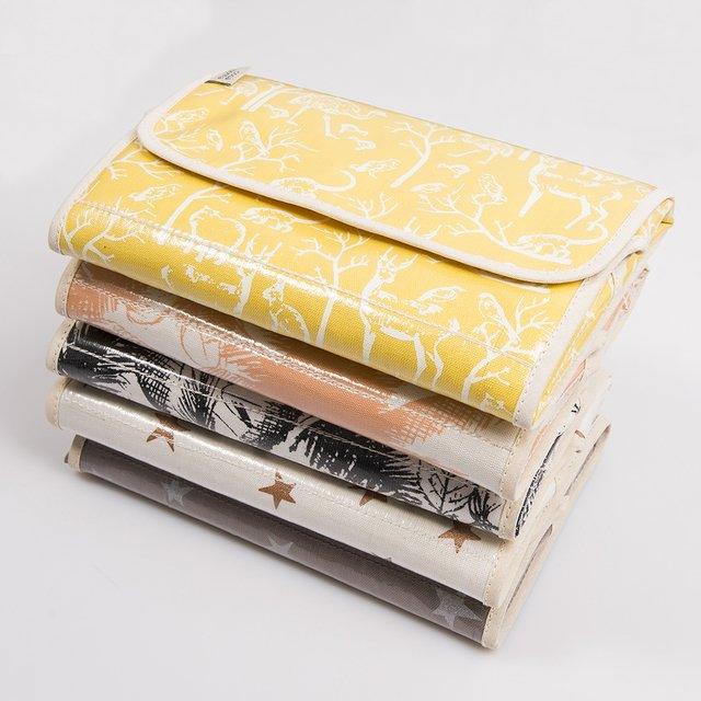 Portable Changing Mat, yellow with white animals - Cosa Bonita