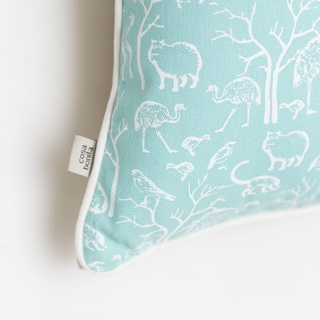 Iruya Cushion, aqua with white animals - Cosa Bonita