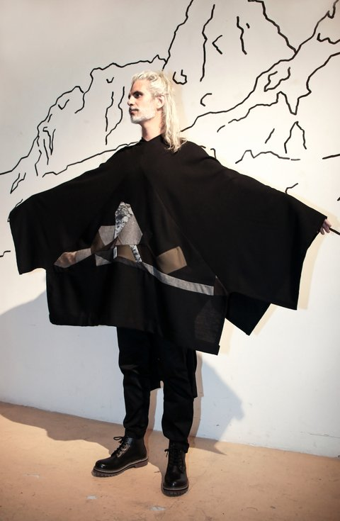 Black poncho with patchwork detail. Made in Argentina