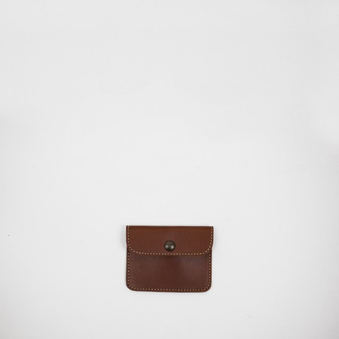 Chestnut 100% veg tanned leather pouch. Fits coins, cards and bills.