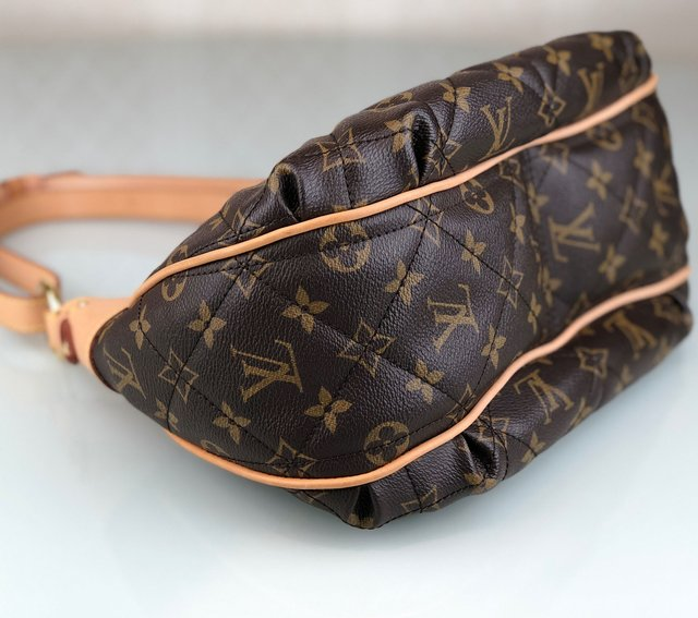 Bolsa Louis Vuitton Monograma Etoile City PM