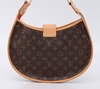 Bolsa Louis Vuitton Perforated Demi Lune - comprar online