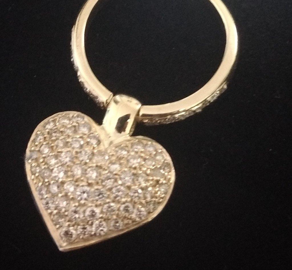 Anel em ouro 18K com diamantes e pingente no formato coração Código  64288b  - comprar 33a43240b9