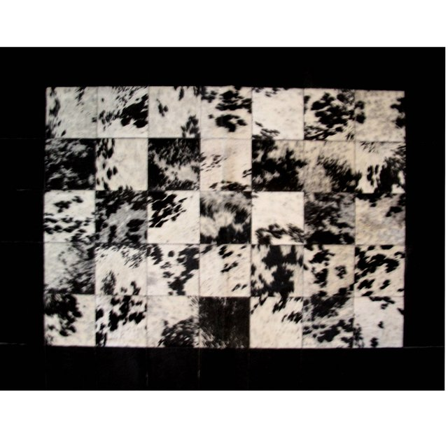 BORDERED BLACK SPLASHED COWHIDE RUG - CALMA CHICHA