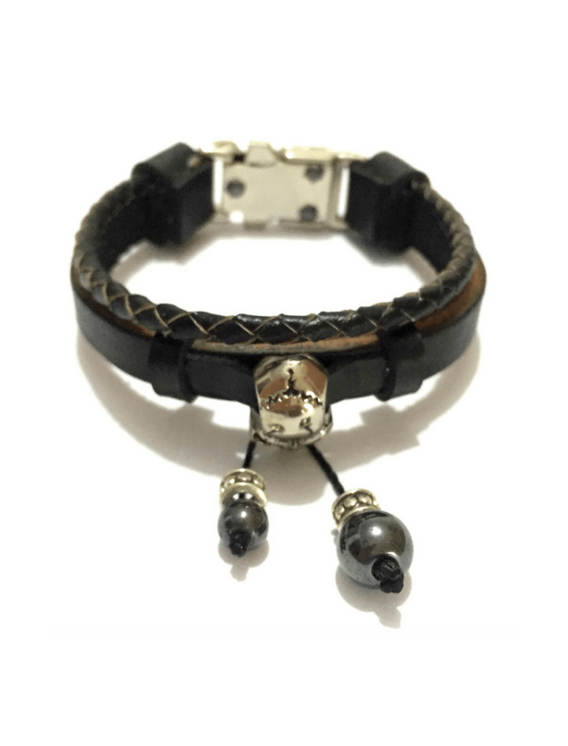 Black leather bracelet with skull and hematite stones.