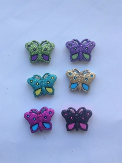 Botones decorativos mariposas brillantes