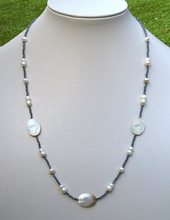 Adriana Necklace with faced hematites, pearls and mother of pearl.