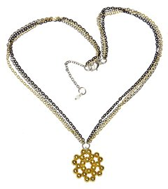 Alexa necklace with three tone chains and a golden mandala pendant