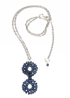 Hannah Necklace with blue crystal pendant and white rhodium chain.