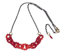Link Necklace with coral bead links, black rhodium chain and golden elements
