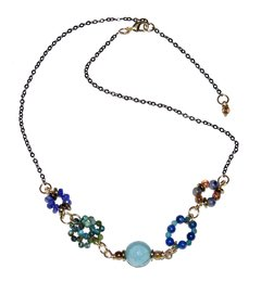 Patchwork Necklace with turquoise, kyanite, sodalite, lapis lazuli, jade, hematite,  czech porcelain, black rhodium chain and golden elements