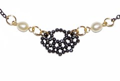 Renda Necklace with faced hematites, pearls, black rhodium and golden elements