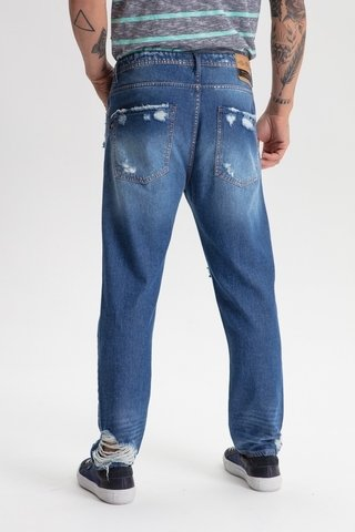 Calça Jeans Taper Slim Destroyed na internet