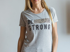 Remera be strong