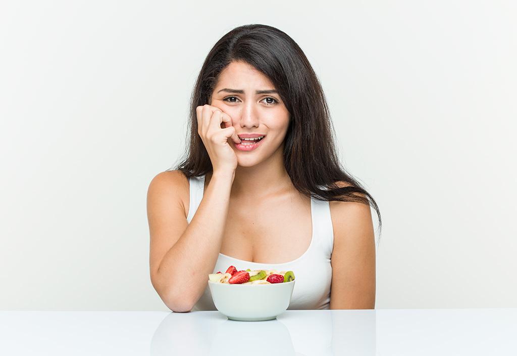 Mulher mudando sua alimentação